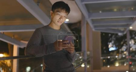 Man using mobile phone at night