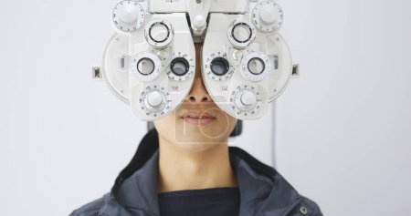 Man checking on eye in clinic...