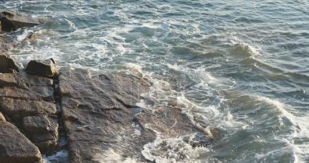 Sea waves on rock coast