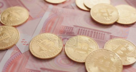 Paper banknotes and bitcoins close up