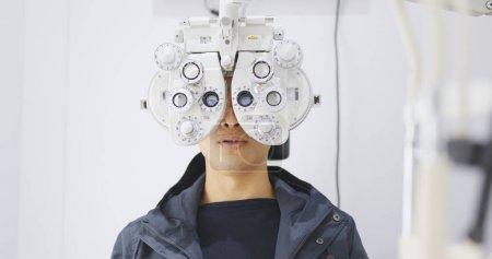 Photo for Man doing eye test - Royalty Free Image