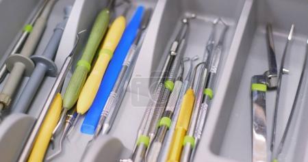 Open the dental tool drawer