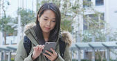 Woman using smartphone at outdoor