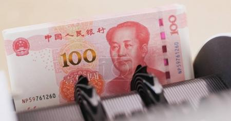 RMB banknotes on counting machine