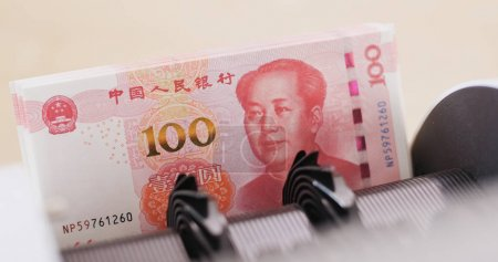 RMB banknotes on automatic counting machine