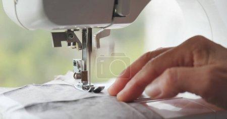 Sewing machine stitching on fabric