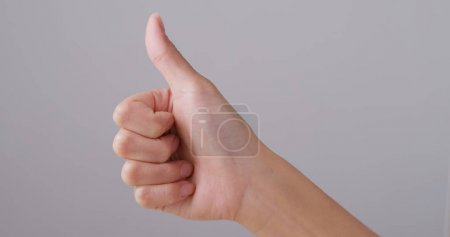 Finger showing thumb up sign