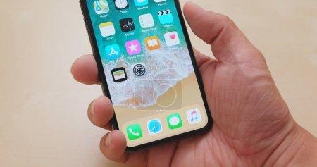 Hong Kong, Hong Kong - 01 March, 2018: Person switching on IphoneX