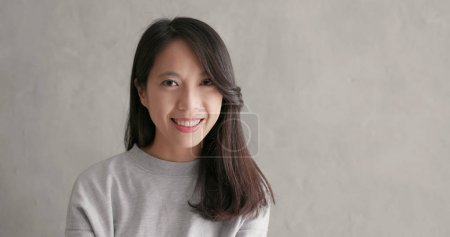 Photo for Young asian woman smiling - Royalty Free Image
