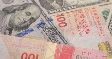 Hong Kong dollars and US dollars