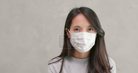 Photo for Woman wearing face mask fro protection - Royalty Free Image