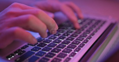Woman Typing on laptop computer keyboard