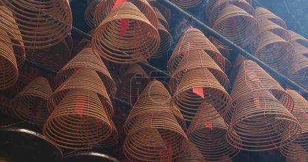 Tai Po, Hong Kong - 12 April, 2018: Man Mo Temple in Hong Kong with incense offerings