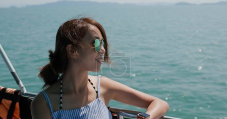 Photo for Woman wear sunglasses and look at the sea on boat - Royalty Free Image