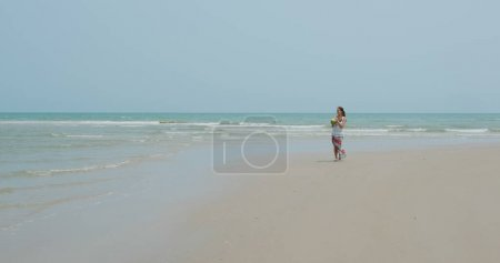 Photo for Woman walk in the beach - Royalty Free Image