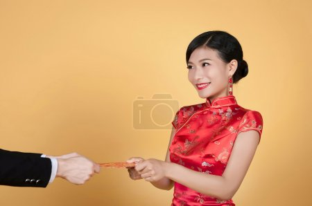 Woman receiving pocket for new year