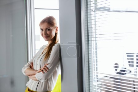 Confident businesswoman with arms crossed