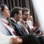 Businessmen discussing over file during seminar...