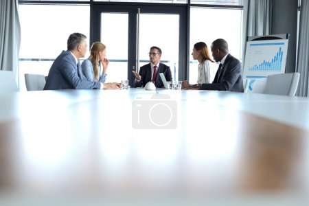 Business people having discussion n board room