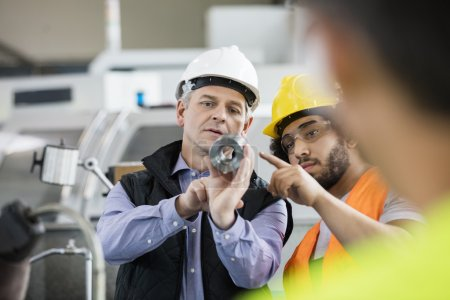 Supervisor and manual worker discussing in industry