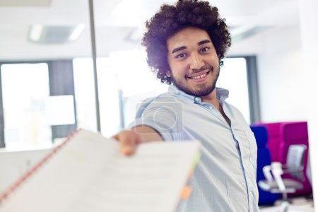 Businessman giving document in office