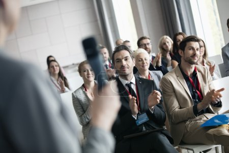 Photo for Business people applauding for public speaker during seminar - Royalty Free Image