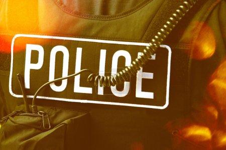 Policeman's sign on protective jacket