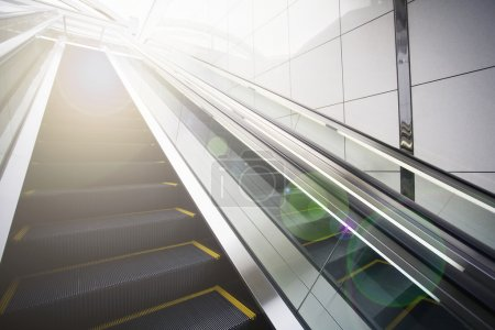 Empty escalator with lens flare