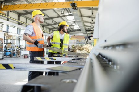 Manual workers manufacturing sheet metal