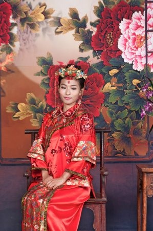 Chinese girl in red traditional dress