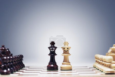 Chess figures on chessboard