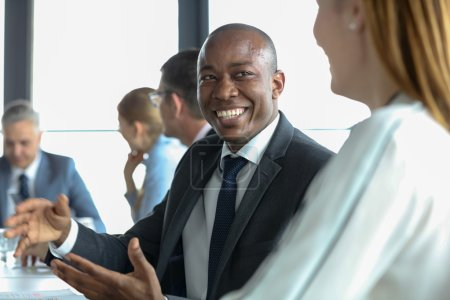 Businessman discussing with colleague in meeting room