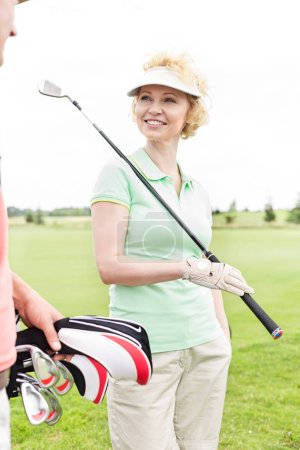 Happy woman at golf course