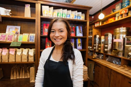 salesperson smiling in coffee shop