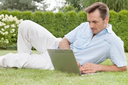 Man using laptop in park