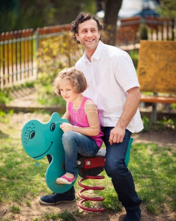 Father and daughter on playground