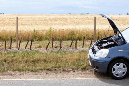 broken car in countryside