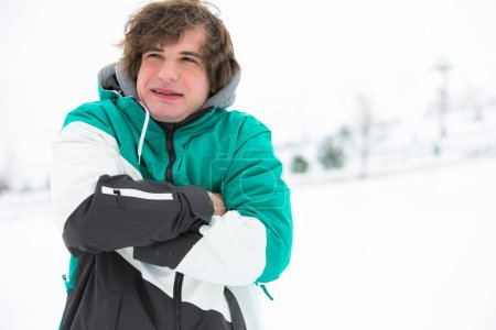 Young man in jacket shivering