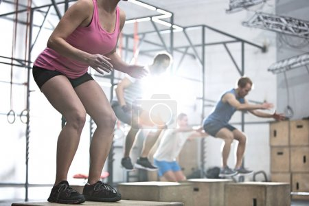 People doing box jump exercise