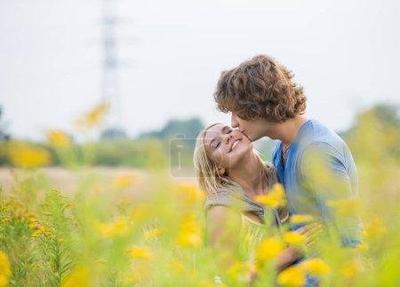 Romantic man kissing woman