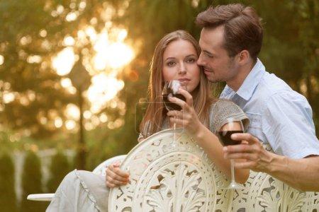 Romantic couple having red wine
