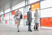 Businesspeople walking in railroad station