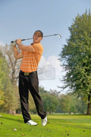 Man swinging golf club