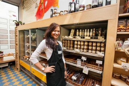 Saleswoman standing in supermarket