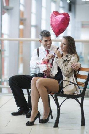 Man gives woman gift