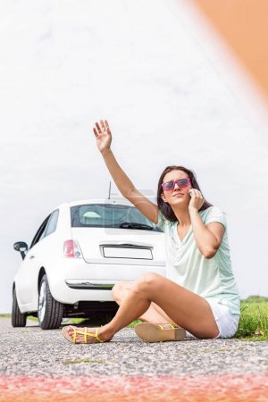 Frustrated woman hitchhiking