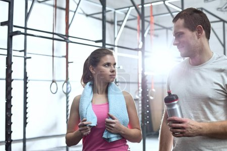 Man and woman in crossfit gym