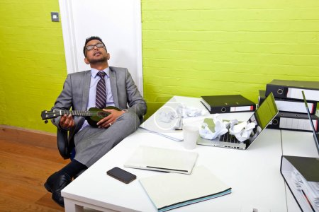 Indian businessman asleep at desk