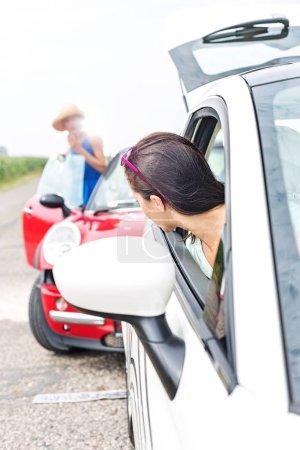 female crashing car on road