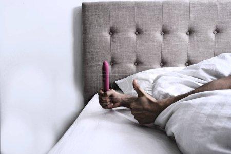 Woman holding a Vibrator Dildo